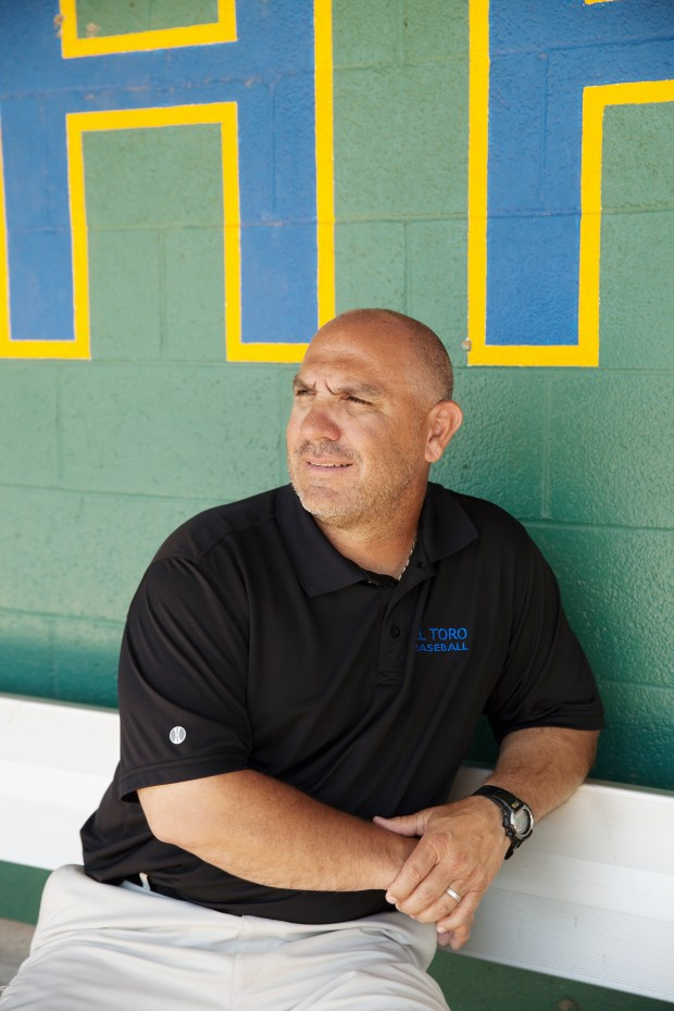 Lake Forest, CA - June 29, 2016: Mike Gonzales, the Head Coach of the El Toro High School baseball team, poses for a portrait at the school's baseball field on Wednesday. Mr Gonzales coached Colorado Rockies third baseman Nolan Arenado at the school. (Photo by Emily Berl/Special to The Denver Post)