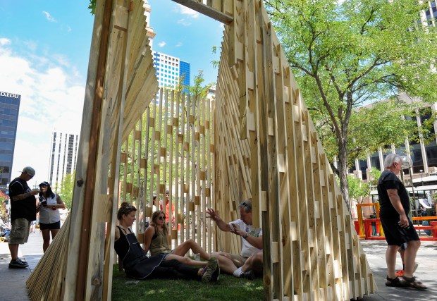 DENVER, CO. - JULY 23: Monika Wittig, left, Stephen Garran, right, and Sophie Fearon sit inside the Aperture prototype by Sort Studio, Meredith Dale and Brian Dale. The Prototyping Festival takes place in downtown Denver along the 16th Street Mall on Saturday, July 23, 2016. (Photo By Kathryn Scott/Special to The Denver Post)