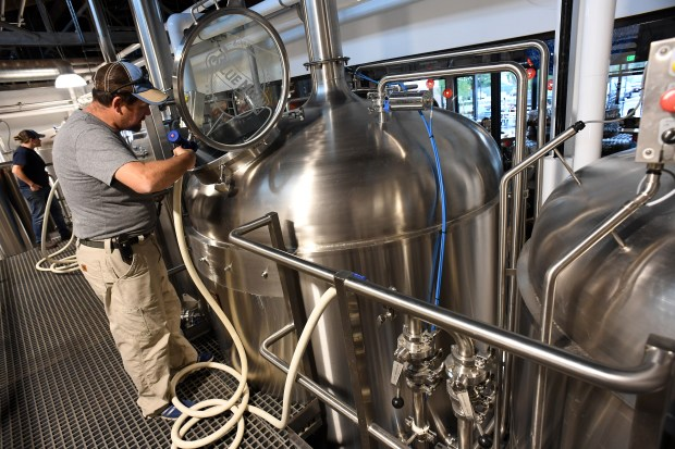 John Legnard, Head brewmaster and manager of the new Blue Moon Brewery, sprays out the lauter tun with water at the newly opened Blue Moon Brewery in the RiNo district on July 21, 2016 in Denver.