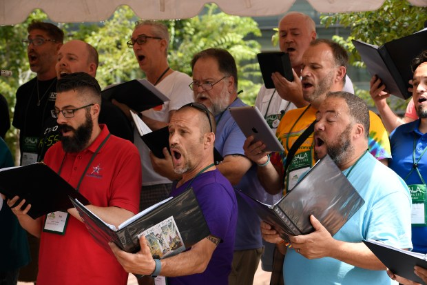 Jon Brockelman, center foreground, and other members of the HIV Positive Festival Chorus sing for a lunchtime crowd in front of Union Station on Tuesday.