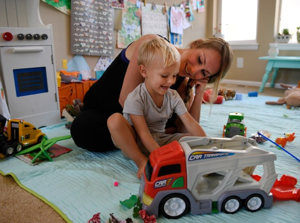 PARKER, CO - July 13: Lindsey Willson plays with her son Bowan, 2, in their living room July 13, 2016. Bowan suffers from food allergies that potentially require the use of EpiPen auto-injectors in an emergency, the Willson's have several on hand to handle any potential problems, but find themselves scraping to pay for the very expensive pens. (Photo by Andy Cross/The Denver Post)