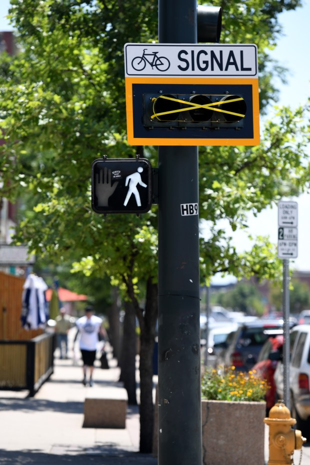 New bicycle signs are being installed along south Broadway on July 27, 2016 in Denver.