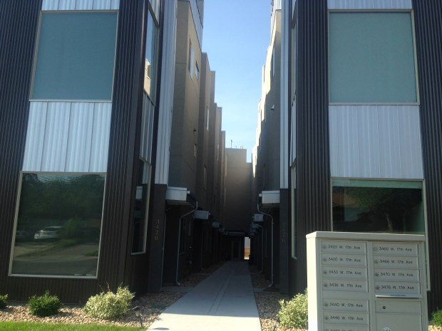 These townhomes on West 17th Avenue near Sloan's Lake have a narrow sidewalk area leading to most of the homes' entrances on the interior of the lot.