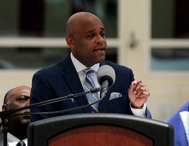 Denver Mayor Michael Hancock delivers his State of the City address Monday from the outdoor plaza at Denver International Airport.