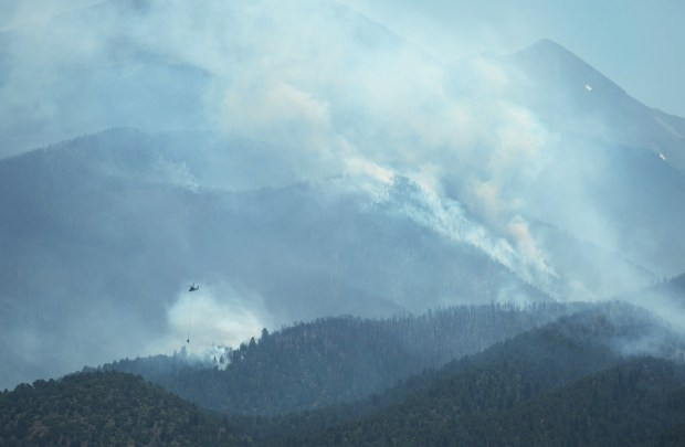 Coaldale, CO - July 13, 2016: A helicopter continued their air assault on the fire to keep the fire away from structures near Coaldale. Crews battling the fire southeast of Salida, which has grown to just 13,000 acres.(Photo by Hyoung Chang/The Denver Post)