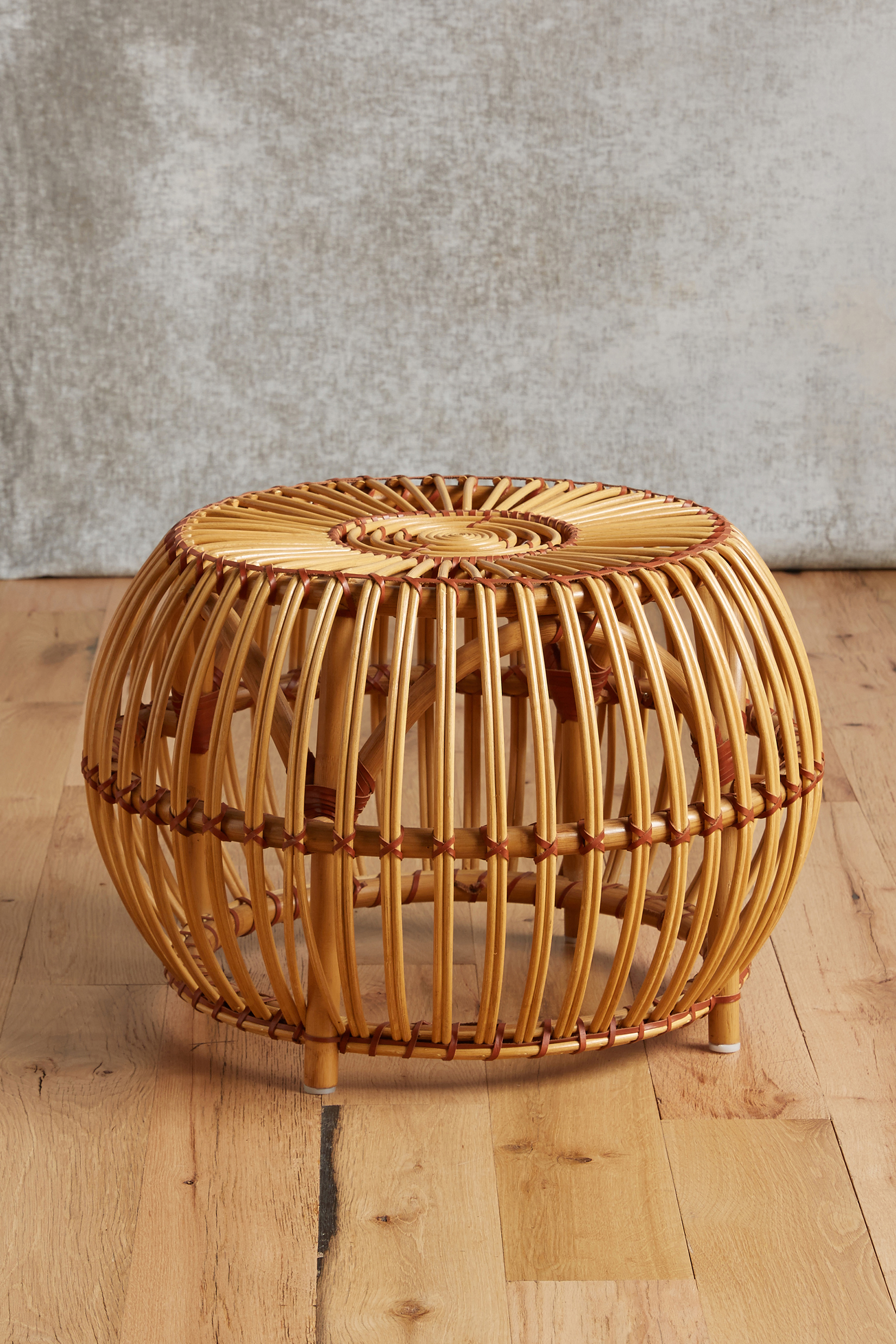 the susila rattan ottoman made of rattan reeds wrapped together with leather is intended