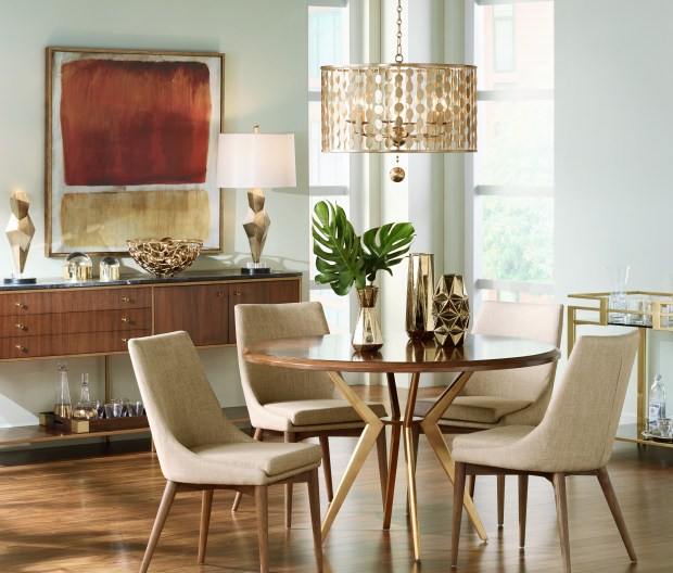 Don't be timid. The number one mistake consumers make when picking light fixtures is going too small. When in doubt, scale up. Light fixtures over dining tables should be about 12 inches smaller than the width of the table. Photo courtesy of Lamps Plus.
