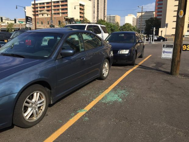 Shattered glass was scattered in a parking lot on Market Street after a midnight shootout that left one mad dead and another man injured.