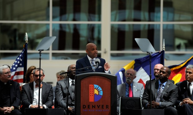 Denver Mayor Michael Hancock delivers his State of the City address Monday from the outdoor plaza at Denver International Airport. Hancock chose not to focus simply on big-picture projects — like the new rail line that took many attendees to the speech — but on building up those who struggle economically.
