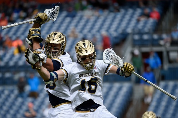 DENVER, CO - MAY 16: Eddy Lubowicki (18) of the Notre Dame Fighting Irish celebrates his goal with Nick Ossello (20) of the Notre Dame Fighting Irish against the Albany Great Danes during Notre Dame's 14-10 NCAA tournament quarterfinal win. Notre Dame played Albany at Sports Authority field at Mile High on Saturday, May 16, 2015. (Photo by AAron Ontiveroz/The Denver Post)
