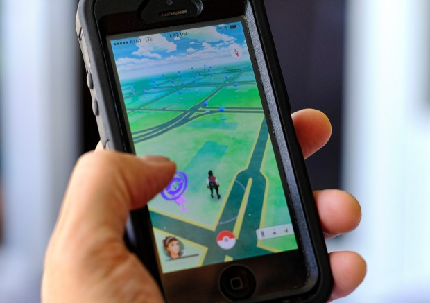 Pokémon Go is displayed on a smartphone in Los Angeles on July 8. Players have reported wiping out in a variety of ways as they wander the real world, eyes glued to their screens, in search of digital creatures.