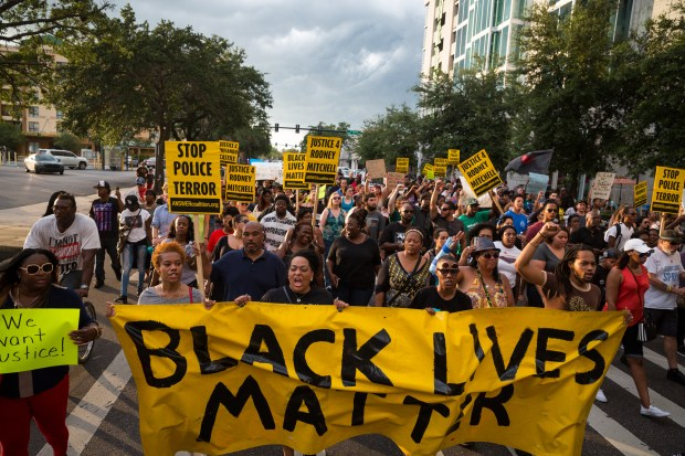 A Black Lives Matter protest, held in response to the deaths of Alton Sterling and Philando Castile, takes place in downtown Tampa on Monday, July 11, 2016. Both Sterling and Castile were shot by police officers the prior week.