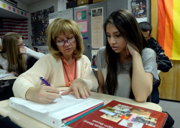 Wheat Ridge High School teacher Stephanie Rossi works with a student in her American History class on Feb. 7, 2014. Colorado is one of four states that don't grant tenure to teachers.