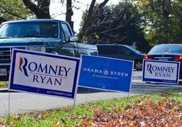 Election signs line the sidewalk in Haymarket, Va., on Nov. 6, 2012.