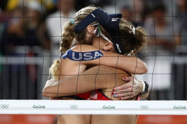 Kerri Walsh Jennings and April Ross of United States celebrate after winning the Women's Beach Volleyball preliminary round match on August 8, 2016 in Rio de Janeiro, Brazil.
