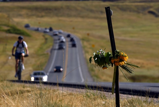 A makeshift memorial sits along U.S. near Boulder, after Ironman triathlon competitor Michelle Walters, 34, was struck and killed by a vehicle during the cycling portion of the Aug. 7 race.