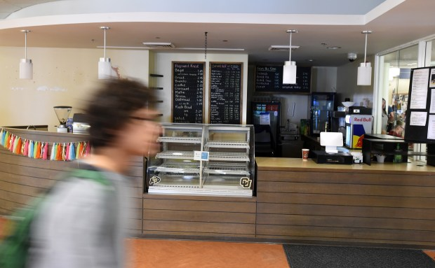 A student walks by the Trep Cafe at the University of Colorado. The cafe operated as a non-profit organization that funded student scholarships. It is now closed.