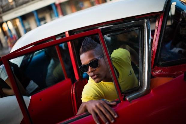 Lediel Escobar, 18, exits a shared taxi in Havana, Cuba.