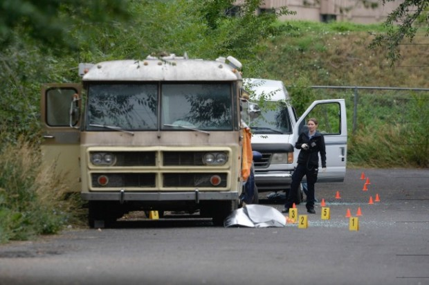 Boulder police process the crime scene at a motorhome on Hickory Avenue where Tuesday night's shooting took place and sparked an overnight manhunt.