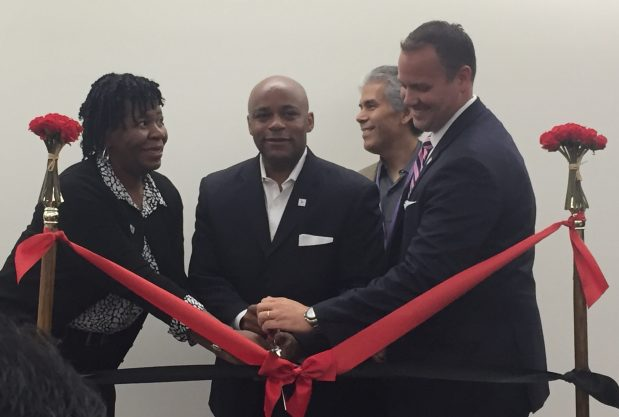 Denver Mayor Michael Hancock cuts a ceremonial ribbon to mark the transition to a private-provider model for city workforce centers on Aug. 1, 2016. With him are Denise Bryant, the Denver director of workforce services, left, Deputy Mayor Don Mares and Michael Hough, the president of Louisville, Ky.-based ResCare Workforce Services.