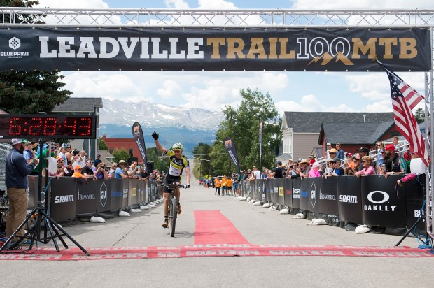 Jeremiah Bishop raises his arm as he finishes third in the Leadville 100 mountain bike race.