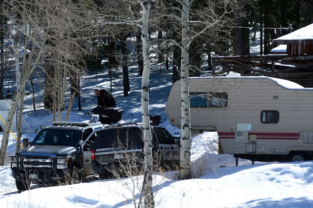 In a file photo, an officer stands the flatbed of a truck next to the home of Martin Wirth, which he was being evicted from which led to the shooting, on February 25, 2016 in Bailey, Colorado.