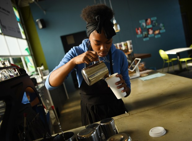 Sha'Ron Wilson pours steamed milk at Prodigy Coffeehouse on Aug. 9, 2016. Prodigy Coffeehouse employs low-income young people and trains them as baristas.