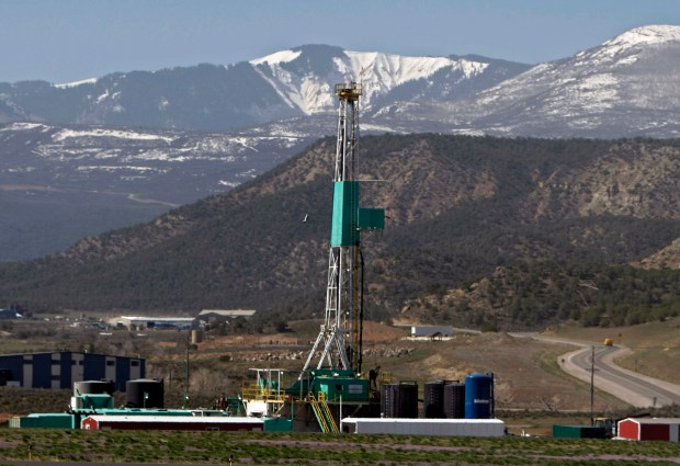 A natural gas well operates in front of Colorado's Roan Plateau in 2008.