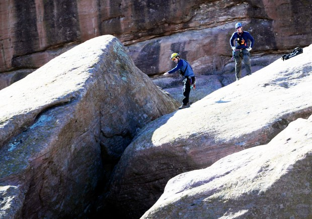 Alpine Search and Rescue team members search an outcropping of the southern end of Red Rocks Park after reports of a possible body on Nov. 23, 2012.