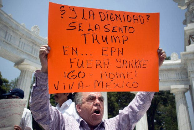 A demonstrator in Mexico City protests against the visit of U.S. presidential candidate Donald Trump on Wednesday.
