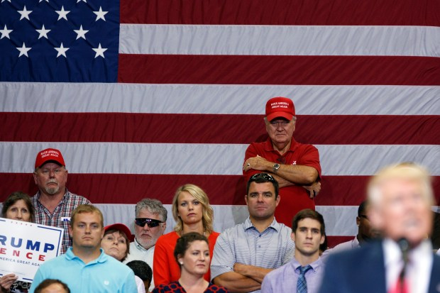 Supporters of Republican presidential nominee Donald Trump watch as he speaks during a campaign rally last Wednesday in Jacksonville, Fla.