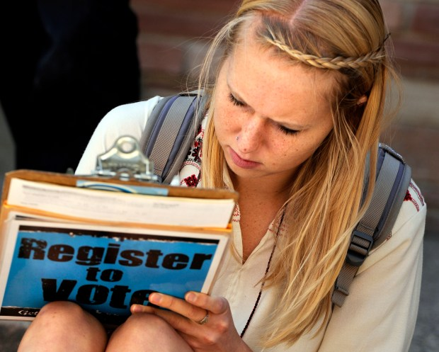 A University of Colorado student fills out a form during a voter registration drive in Boulder on Sept. 21, 2011.