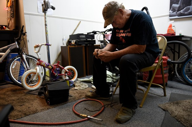 AURORA, CO - JULY 27: Leonard Carleton works on repairing a bike chain at Second Chance Bike Shop in Aurora, Colorado on July 27, 2016. Six months ago, Aurora approved the creation of a new 6.8-acre urban renewal area at the northeast corner of South Sable Street and East Alameda Avenue for the redevelopment of the existing bank and shopping center into a quality transit-oriented development. The center, like many in Aurora, has been in decline, but this particular one is planned to be at the city center stop of the R-Line. (Photo by Seth McConnell/The Denver Post)