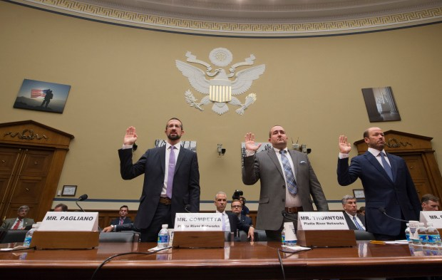 Witnesses, from left, Paul Combetta, Platte River Networks, Bill Thornton, Platte River Networks, and Justin Cooper are sworn in on Capitol Hill in Washingtonn
