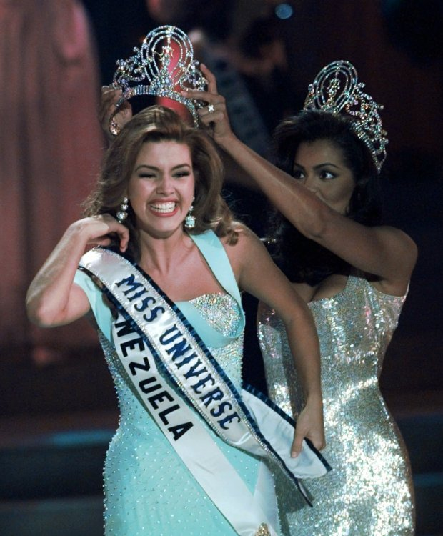 In this May 17, 1996, file photo, the new Miss Universe Alicia Machado of Venezuela reacts as she is crowned by the 1995 winner Chelsi Smith at the Miss Universe competition in Las Vegas.