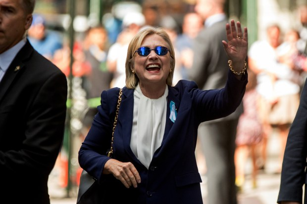"Democratic presidential nominee Hillary Clinton waves after leaving an apartment building on Sept. 11 in New York. Clinton's campaign said she left the 9/11 anniversary ceremony in New York early after feeling ""overheated."" Later, the campaign revealed that she'd been diagnosed with pneumonia two days earlier."