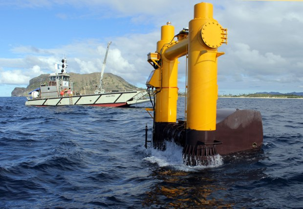 This 2015 photo provided by Northwest Energy Innovations shows the Azura wave energy device, which is converting the movement of waves into electricity at the Navy's Wave Energy Test Site at the Marine Corps base at Kaneohe Bay on Oahu in Hawaii. By some estimates, the ocean's endless motion packs enough power to meet a quarter of America's energy needs and dramatically reduce the nation's reliance on oil, gas and coal. But wave energy technology lags well behind wind and solar power.