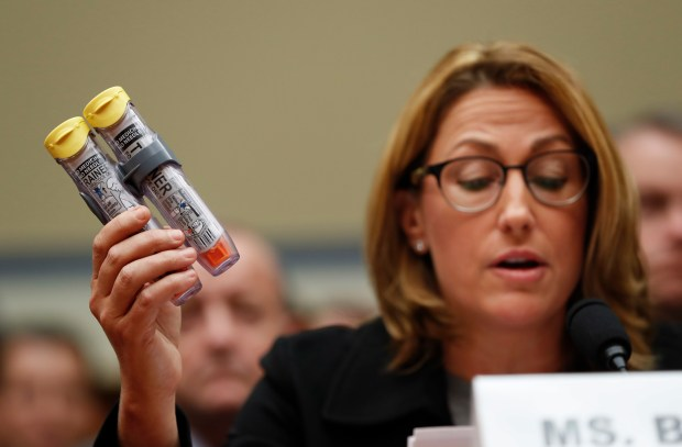 Mylan CEO Heather Bresch holds up an EpiPen while testifying on Sept. 21 before the House Oversight Committee hearing on EpiPen price increases.