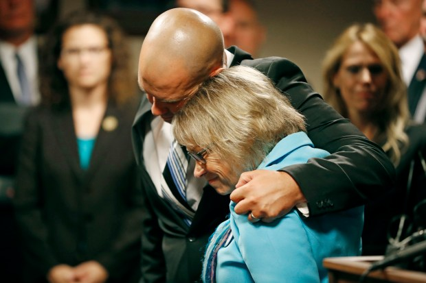Patty Wetterling is consoled by son Trevor during a news conference after a hearing for Danny Heinrich on Tuesday in Minneapolis. Heinrich confessed Tuesday to abducting and killing 11-year-old Jacob Wetterling nearly 27 years ago.