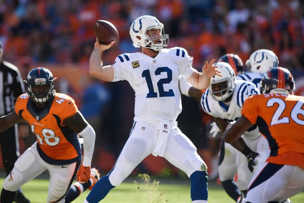 Andrew Luck (12) of the Indianapolis Colts throws against the Denver Broncos during the third quarter. The Denver Broncos hosted the Indianapolis Colts on Sunday, September 18, 2016. John Leyba, The Denver Post