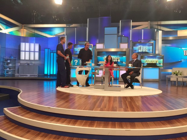 "The set of ""The Doctors."" At far left is one of the hosts, ER physician Dr. Travis Stork; at far right is co-host plastic surgeon and reconstructive surgery expert Dr. Andrew Ordon."