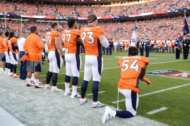 DENVER, CO - SEPTEMBER 08: Linebacker Brandon Marshall (54) of the Denver Broncos takes a knee during the national anthem before the first quarter. The Denver Broncos hosted the Carolina Panthers on Thursday, September 8, 2016. (Photo by John Leyba/The Denver Post via Getty Images)
