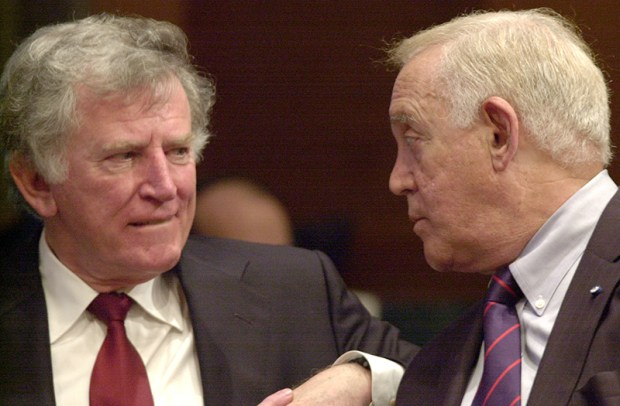 Former U.S. Sens. Gary Hart, left, and Warren Rudman speak before testifying at a June 20, 2002, Senate Government Affairs Committee hearing on President Bush's proposal to make the office of Homeland Security a Cabinet-level position.