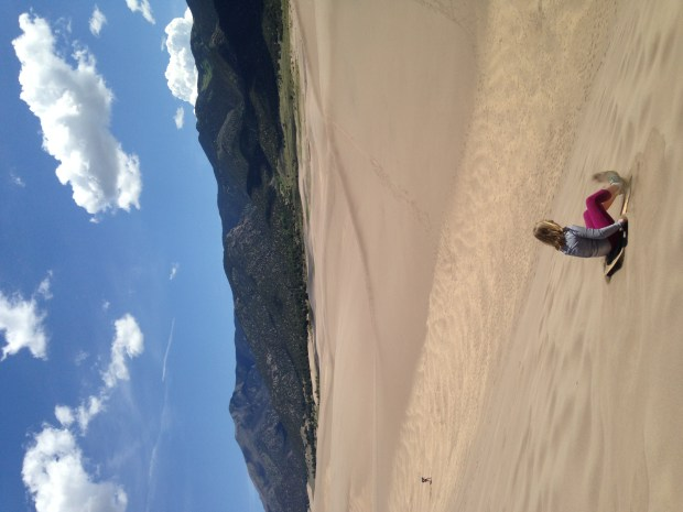 Sledding is a year-round option at Great Sand Dunes National Park. Photo by Chryss Cada, Special to The Denver Post