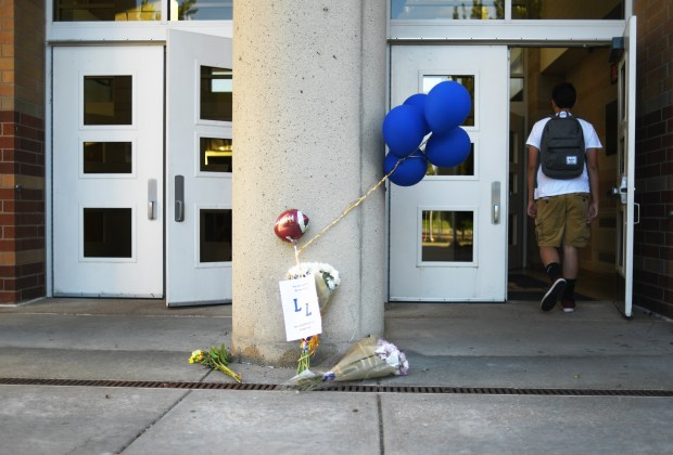 A student arrives at Legacy High School, Sept. 12, 2016. An Adams County school bus driver was killed and members of Legacy High School football team and coaches were hurt in a bus crash at Denver International Airport.