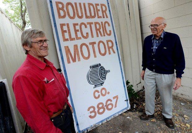 Bill Thielman, Jr., left, and his father, Bill, stand by the sign they removed from the building. After 41 years in business, Boulder Electric Motor Co. owner Bill Thielman, 89, and his son Billy, 64, are calling it quits, a move that is sending hundreds of their Boulder County customers into deep mourning.