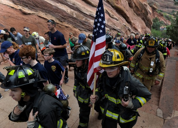 Climbers make the ascent up the stairs on one side of the theatre. Thousands gather for the 2016 Colorado 9/11 Memorial Stair Climb-15 Year Commemoration at Red Rocks Amphitheatre in Morrison, CO on Sunday, Sept. 11, 2016. As a way to honor and remember the FDNY firefighters who gave their lives on 9/11/2001, each participant climbs the equivalent of 110 stories of the World Trade Center with nine laps on the stairs around the amphitheatre.