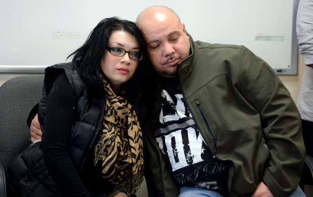 Michelle Cruz, the Aunt of Demitrius Cruz, gets a hug from Lydell Gomez during a press conference for any information about the shooting and the death of Demitrius Cruz.