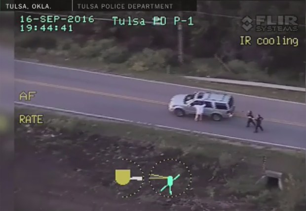 In this image from video provided by the Tulsa Police Department, Terence Crutcher is seen next to his SUV moments before he was shot and killed by a police officer.