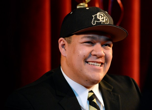 Tim Lynott wears Buffs gear after signing with Colorado